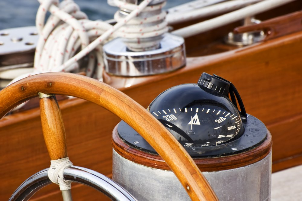 Where should a boat compass be mounted